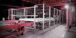 A red and silver large enclosure inside of an industrial building
