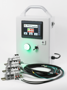 A white Power/mation kit with a working screen and illuminated green light standing next to black and green cables